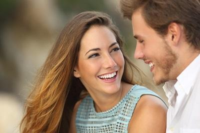 Young couple smiling looking at each other l Cosmetic dentist High Point NC