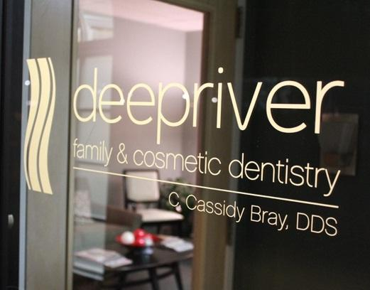 the door of our high point nc dental office, featuring signage